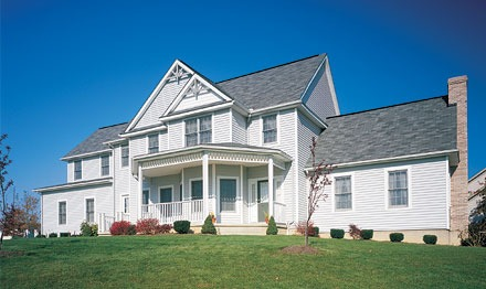 Vinyl siding vs brick siding a comparison guide - Exterior paint calculator by square foot ...