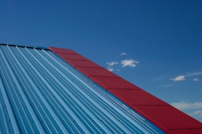 Blue and red metal roofing. Photo by wolv on iStockphoto.