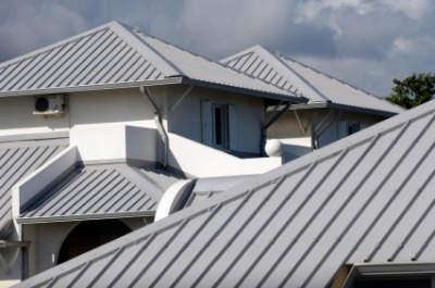 Gray metal roofs at an apartment complex. Photo by titine974 on iStockphoto.